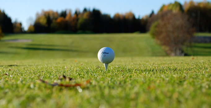 golf ball resting atop a tee